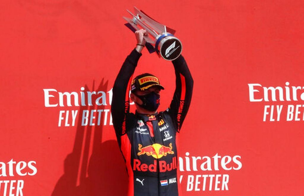 Max Verstappen lifts the winners trophy at the F1 70th Anniversary GP